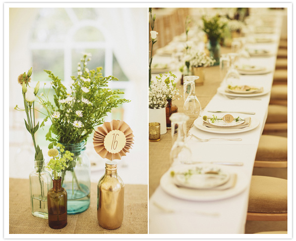 simple floral centerpieces in colored bottles