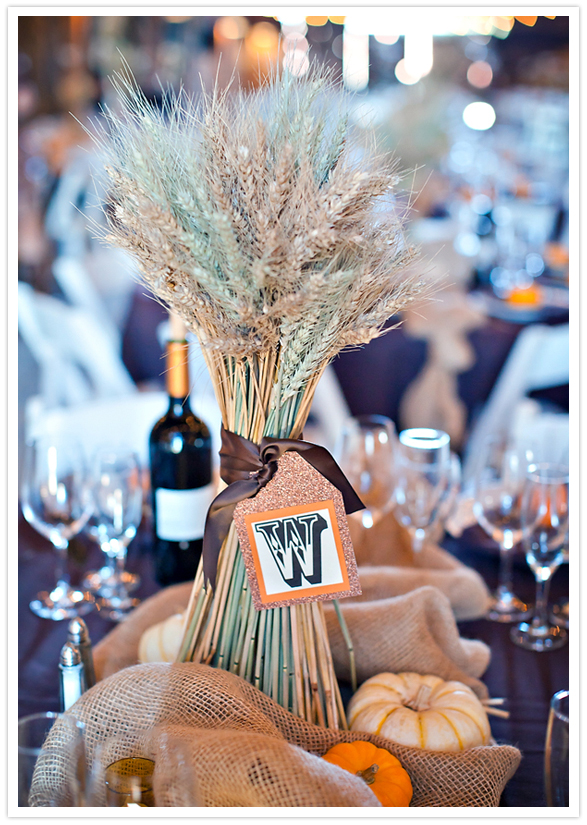 gathered wheat centerpieces with paper monogram tags