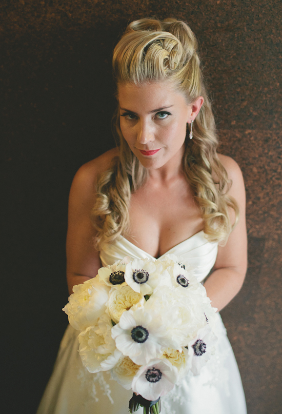 sweetheart cut dress and black and white anemones bouquet