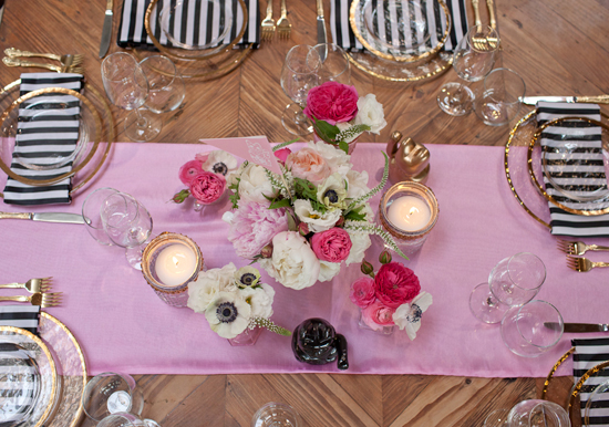 pink florals and linens and black and white striped napkins