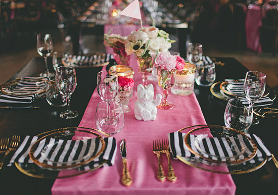 pink table runner, black and white striped napkins and gold flatware