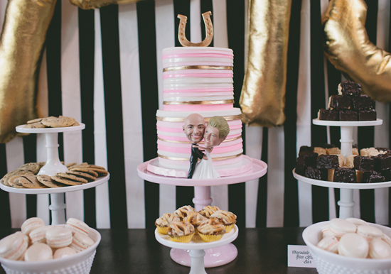 pink, gold and white striped cake and horseshoe cake topper
