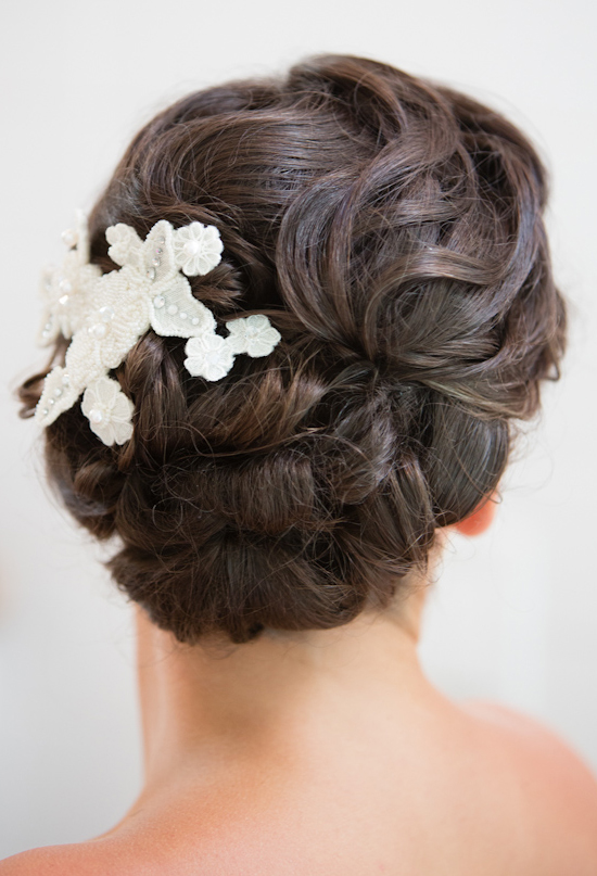 twisted up-do with white, beaded barrettes
