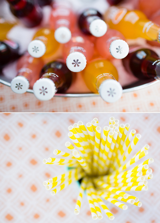 colorful bottled sodas and yellow striped straws