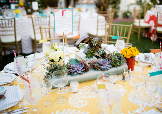 long succulent centerpieces and colorful floral accents and linens