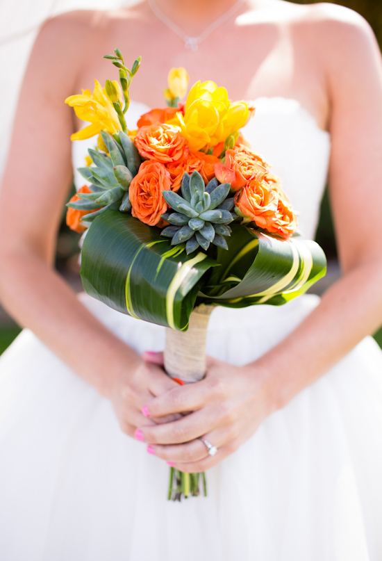 orange and yellow flowers mixed with succulents bouquet