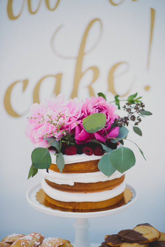 Naked cake with floral topper | Photo by Katie Pritchard Photo | Read more - https://www.100layercake.com/blog/?p=76900