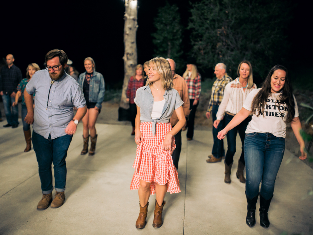 Line dancing at 40th anniversary party by Amorology