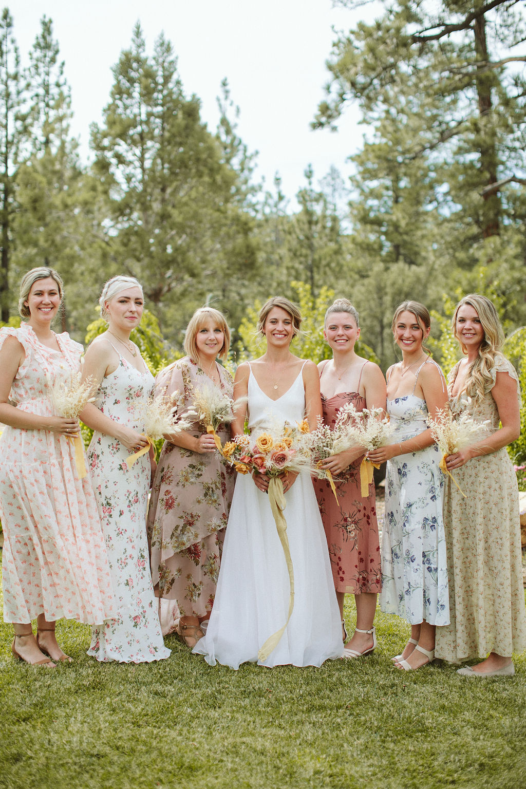 Steph + Austin Hendrix wedding by Paige Jones - floral bridesmaid dresses