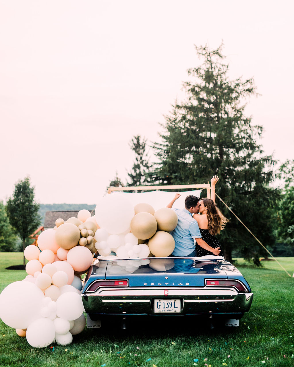 An Enchanting DIY Drive In Engagement Shoot at Golden Hour